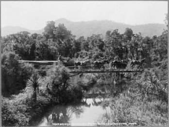 Swamp area in the Rai Valley, Marlborough, with horses hauling a log over a tramway bridge. Photograph taken circa 14 December 1912, by James Raglan Akersten.