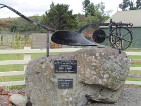 The rock and historic plough marking Apiti's centennial. Photo: C. Knight