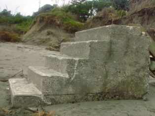 Steps to the backyard of an eroded property on a Kapiti Coast beach