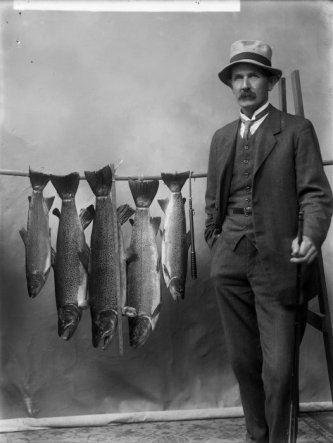 Mr Clark with trout. Ref: 1/1-005184-G. Alexander Turnbull Library, Wellington.