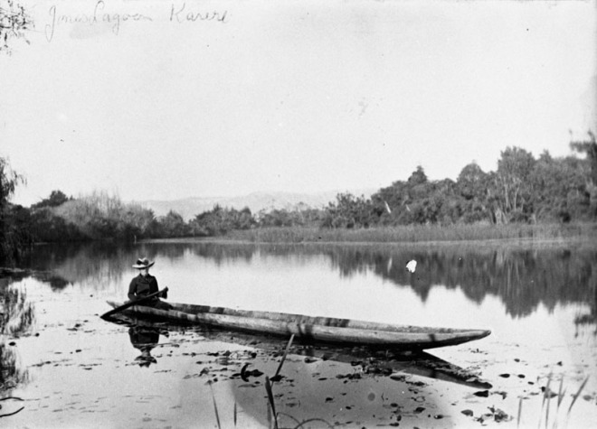 Woman paddling in dugout canoe in Jone's Lagoon, Karere, c1905. Palmerston North City Library, 2007N_Lo27_BRW_0609